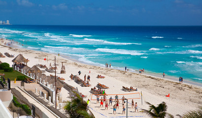 Mexico, Cancun. People relaxing and sunbathing on the beach