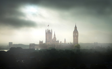 Big Ben and Houses of Parliament at dark misty day. London, UK