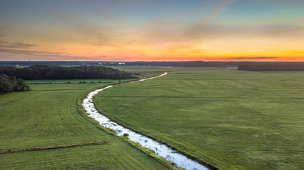 Wall Mural - Aerial view of lowland river