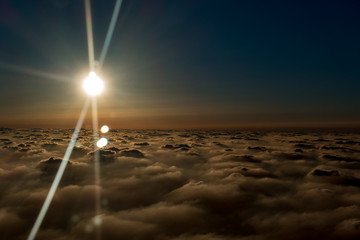 sun above the clouds, the view from the plane