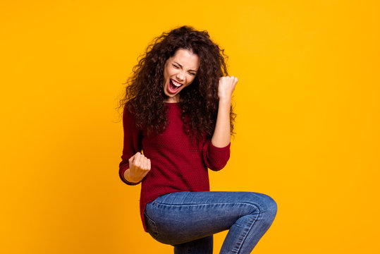 Close up photo amazing beautiful her she lady all possible yell voice raised fists hip in delight like rock star guitar wear red knitted sweater pullover clothes outfit isolated yellow background