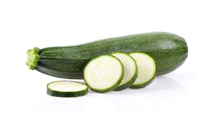 fresh zucchini with slice isolated on white background