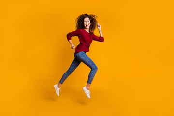 Full length body size view of her she nice pretty attractive cheerful cheery sportive slim thin fit wavy-haired lady running rush hour isolated on bright vivid shine orange background
