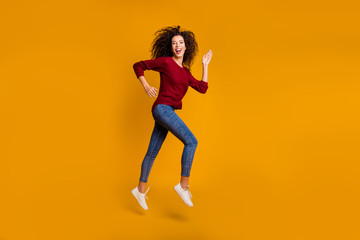 Full length body size view of her she nice cute lovely pretty attractive cheerful cheery sporty slim thin fit wavy-haired lady running contest isolated on bright vivid shine orange background
