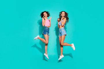 Wall Mural - Full length body size side profile photo jumping beautiful funky wavy she her ladies hands arms raised great fortune wearing shiny jeans denim shorts tank tops isolated teal bright vivid background