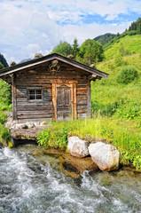 barn on schwarzachbach stream in tyrol austria.