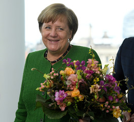 Chancellor Angela Merkel receives Valentine's Day flowers in Berlin