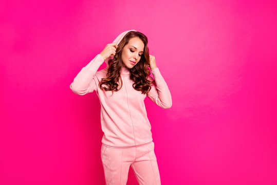 Close up photo amazing beautiful she her lady imagination flight romantic mood looking down shy put on hood wearing modern casual pink pullover outfit isolated vibrant vivid rose background