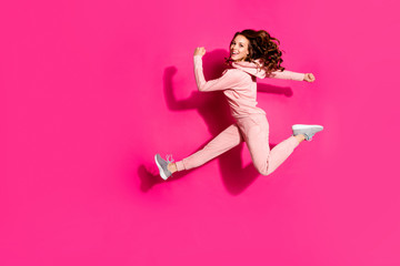 Full length body size photo crazy lifestyle flight high amazing she her lady hands arms help rush shopping wearing modern casual pink costume suit pullover outfit isolated vibrant rose background
