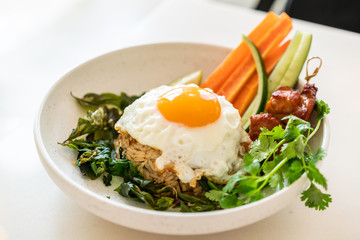 spicy fried rice with fried egg and vegetable