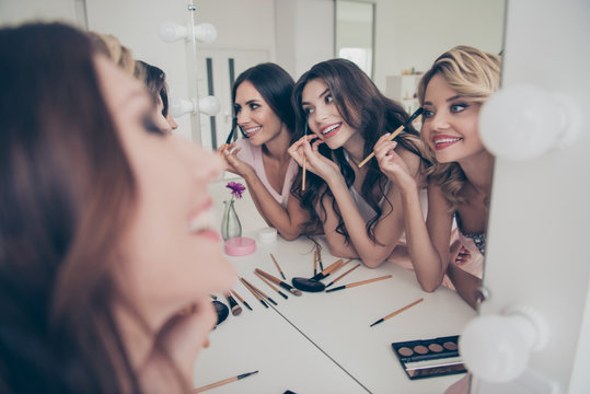 Portrait of nice cute fascinating attractive lovely well-groomed glamorous shine cheerful girlfriends having fun domestic skin care in light white interior decorated house indoors