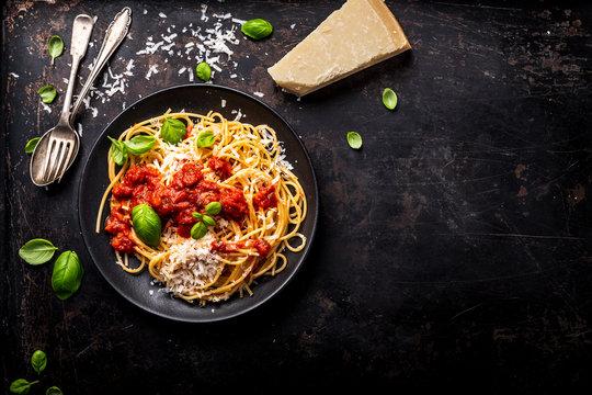delicious appetizing classic spaghetti pasta with tomato sauce, parmesan