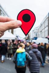 man with a red marker in Portobello Road, London