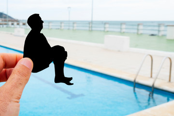 silhouette of a man throwing himself into a pool