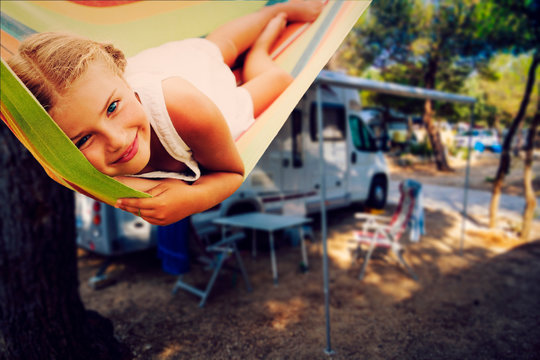 Camping RV travel with camper, summer beach. Happy smiling beauty girl on mototorhome vacation.