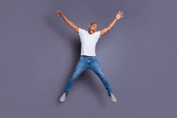 Full length body size portrait of his he nice handsome attractive masculine virile guy wearing white shirt jeans having fun isolated over gray violet purple pastel background