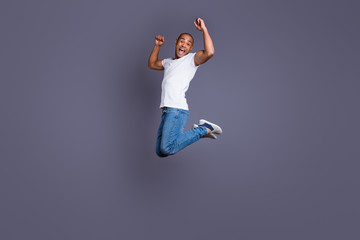 Full length body size portrait of his he nice handsome attractive masculine cheerful cheery crazy guy in white shirt jeans having fun triumph look outfit isolated over gray pastel background