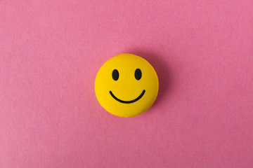 Funny smiley face on pink background. Positive mood. Empty text space.
