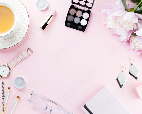 Beautiful cosmetics and flowers flat lay with note book, herbal tea