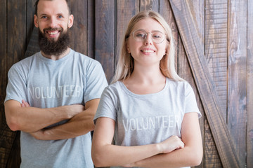 Volunteer youth. Modern family concept. Happy young couple ready to help.