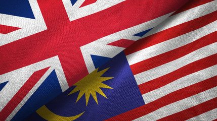 United Kingdom and Malaysia two flags textile cloth, fabric texture