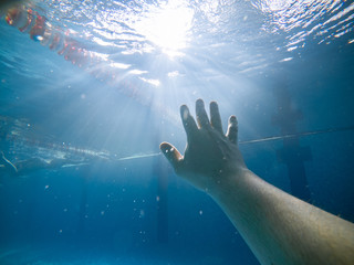first person view. drowning man under water. air bubbles. hand Fototapete