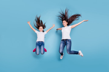 Full length body size view of two nice crazy lovely winsome attractive adorable cheerful cheery slim sporty people in white t-shirt rejoice isolated over blue pastel background