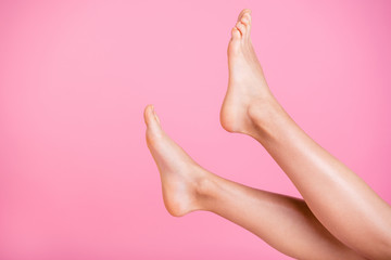 Cropped close-up image view photo of nice perfect feminine fit slim soft smooth shine shaven legs ad advert healthy lifestyle active moving life isolated over pink pastel background