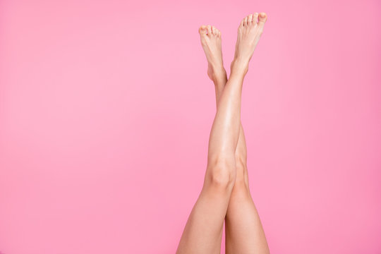 Cropped close-up image view photo of nice perfect long attractive feminine fit thin slim soft smooth shine shaven legs ad advert isolated over pink pastel background