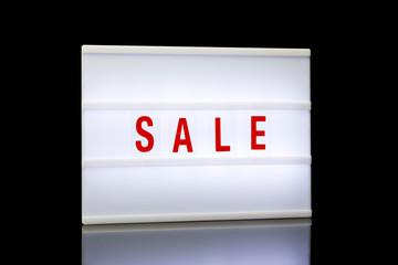 Sale, word written on lightbox