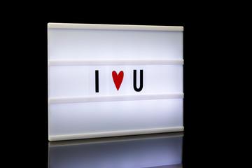 I love you, acronym written on lightbox