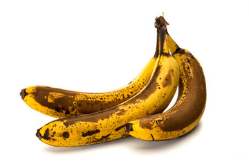 Stained bananas isolated on white background
