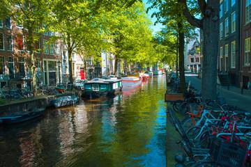 amsterdam canal under morning sun
