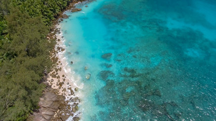 Wall Murals Turquoise Beautiful aerial view of Seychelles beach from a drone perspective