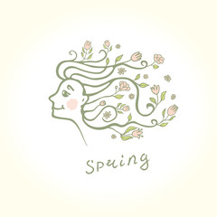 Profile of a beautiful girl with flowers in her hair. Spring flower hairstyle.