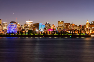 Night view of the Montreal city skyline, city hall with St Lawrence river