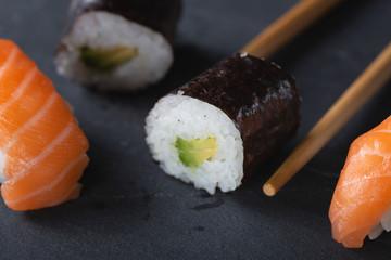 Fresh seafood sushi meal on darck background
