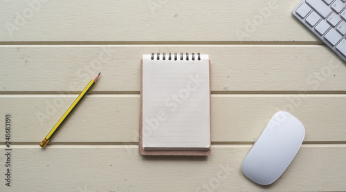 Wall mural Working space, notebook, with keyboard on white wooden desk