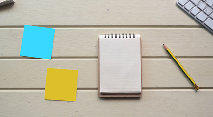 Wall Mural - Working space, notebook with post it and keyboard  on white wooden desk