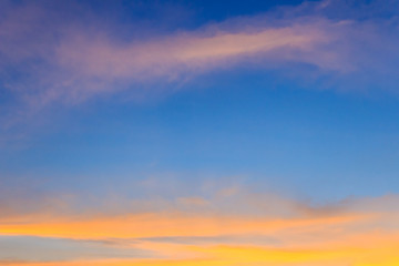 Beautiful red, orange and yellow clouds and blue sky background. Colorful exotic sky with orange clouds and blue sky on background