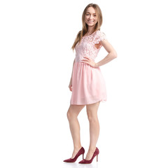 Woman in pink dress and red high heel shoes on white background isolation