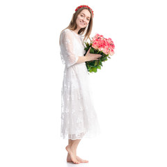 Woman in dress with flowers roses in hand on white background isolation