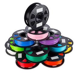 colorful bright stack pile of spool 3d printer filament