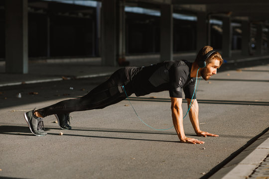Young man doing push ups in the urban environment