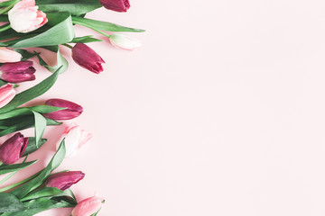 Flowers composition. Tulip flowers on pastel pink background. Valentines day, mothers day, womens day, spring, easter concept. Flat lay, top view, copy space
