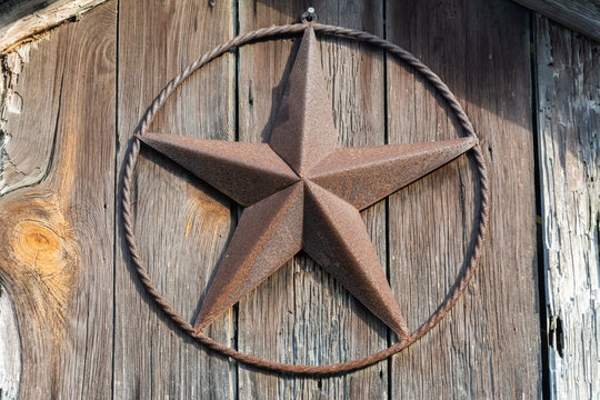 Lone Star sign on a wooden door in Texas.