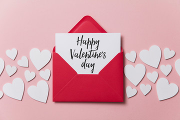 Happy Valentine's day white card with red paper envelope