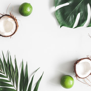 Summer composition. Tropical palm leaves, fruits on pastel gray background. Summer concept. Flat lay, top view, copy space, square