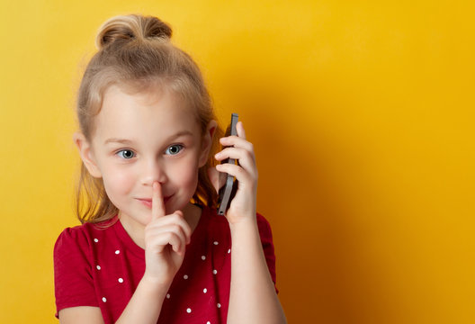 little girl 5 years old talking on a cell phone , place for text