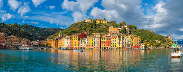 Colorful houses and yachts in spectacular bay harbor of Portofino in the province of Genoa, Italy